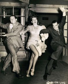 "Rita Hayworth (1918-1987), with Gene Kelly (1912-1996) and Phil Silver (1911-1985), on the set of Charles Vidor's film, ""Cover Girl,"" 1944"