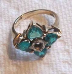 Vintage-10K-yellow-gold-Kimberly-Jewelers-ring-w-blue-topaz-sidestones