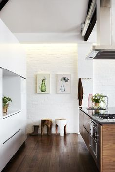 The strong images at the end of this long and simple kitchen really pop, they're like sirens wanting you to come closer to see what they're really like.