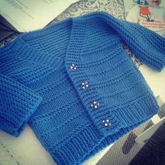 Simple Style Baby Cardigan and Hat pattern by Lion Brand Ya Baby Cardigan Knitting Pattern Free, Baby Boy Knitting Patterns, Knitted Baby Cardigan, Cardigan Pattern, Baby Boy Jackets, Knitting Blogs, Crochet Baby Clothes, Baby Sweaters, Knitting Sweaters