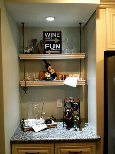 Wine bar in my kitchen is the perfect place to store all barware and wine. Great use of the floater shelves.