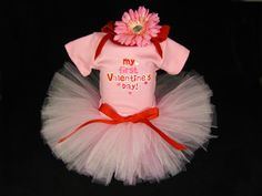 This cute Valentine's Day set includes a pink bodysuit, tutu and free flower headband. To make our handmade tutu we use yards of soft tulle,