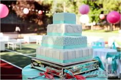 Blue and white square wedding cake.