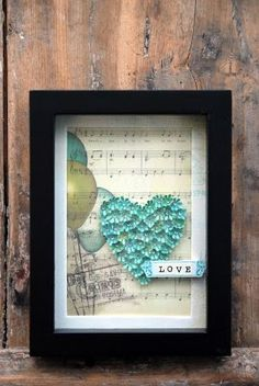 I put this here because I have some scrapbook paper thats christmas notes, and I thought it would be adorable to make a mini shadow box with a christmas theme.....when I get around to it! LOL
