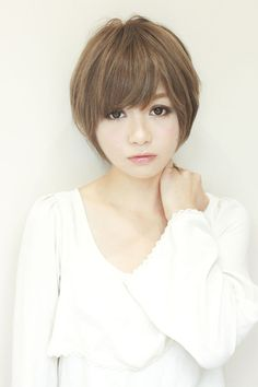 Short Japanese. Altho' a bit chunky this is a good example of a haircut in proportion to face/head size.
