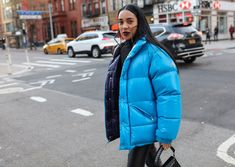 Aleali May in a Moncler coat and Area earrings