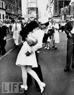 """World War II: The Kiss  No single picture from World War II -- in fact, arguably, no single 20th-century photograph -- is more famous than Alfred Eisenstaedt's """"VJ Day in Times Square."""" In its spontaneity, energy, and abandon, the photograph of a sailor grabbing and kissing a passing nurse as news of Japan's surrender rockets around the globe encapsulates an entire country's response to the war's end. Of course, not everyone ran outside and kissed strangers on the mouth on August 14, 1945 -- but when this photo appeared in LIFE (not on the cover, but as just one of many pictures taken around the country on the great day), countless readers were drawn to the story it told: a man and a woman, both in uniform, both young, in the very heart of America's greatest city, celebrating the end of a long, brutal conflict with that most unwarlike of gestures: a lingering, """"Who cares who sees us?"""" kiss."""