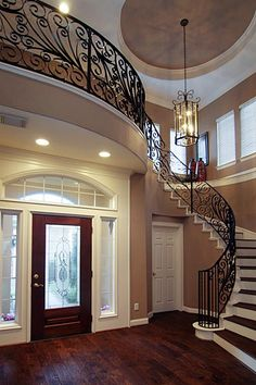 Sellers had this gorgeous custom designed staircase made to create this elegant entrance. Notice the high ceilings, chandelier, natural light and warm designer paint colors making move in easy - ready to go!