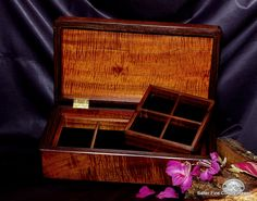 Jewelry Box of exotic curly koa wood. Approx 13 x 7 x 4 inches. Velvet lined with 2 removable trays. Trays have removable internal dividers for easy customized use for man or lady. Available at SalterFineCutlery.com