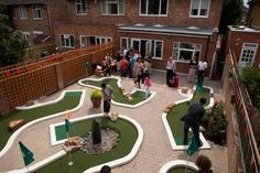 Guests enjoying the minigolf Golf Putting Green, Crazy Golf, Miniature Golf, Putt Putt, North London, Back Gardens, Water Features, Baseball Field, Golf Courses