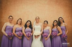 light purple/lavender bridesmaid dresses. purple and pink flowers. lace veil, lace wedding dress.