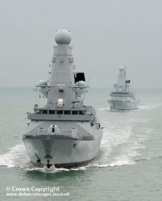 Type 45 destroyers together for the first time.    HMS Daring (rear) and Dauntless (front) conduct Officer of the Watch manoeuvres south of the Isle of Wight.  The Royal Navy's two new formidable air defence destroyers performed side by side for the first time.