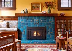 Caribbean blue tile fireplace by Motawi Tileworks featuring Nouveau and Cicero relief tile Craftsman Fireplace, Tile Fireplace, Fireplace Mantles, Fireplace Remodel, Painted Fireplaces, Fireplace Makeovers, Cabin Fireplace, Vintage Fireplace, Stone Fireplaces