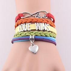 Show your pride and support by wearing this fabulous LOVE WINS infinity love charm bracelet. Length:17+5cm