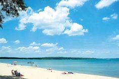Traverse City, MI  Beautiful Beach on Michigan Lake.  Also in Early July has a FUN Cherry Festival.