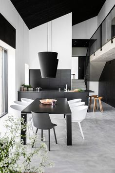 Contrasting black and white in a project with concrete floors by Kaipainen Architects
