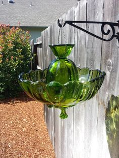 Green glass hanging bird feeder by SingleMommyMadness on Etsy, $48.00