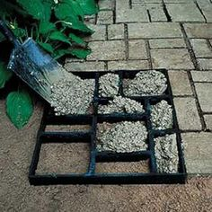 Make a garden path using a multi picture frame. Fill the frames with cement. B says this will work, just oil the frame so it releases easy.