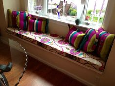 Beautiful Retro Bench Cushion and Designer Pillows featuring Mulberry Petals (27679-MUL) and Mulberry Paint Stripe (28060-MULY) fabrics.