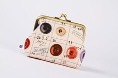 ButtonArtMuseum.com - Deep dad - Colorful buttons on off white  - metal frame purse. $23.00, via Etsy.