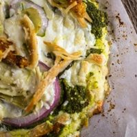 Swap high calorie pizza crust for a low carb version made with cauliflower.