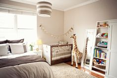 Sharing Sleep By keeping everything in the room neutral, the baby's space blends seamlessly with adult furnishings. The striped Oilo double pendant lamp adds additional visual interest to the room. Source: Studio 1208