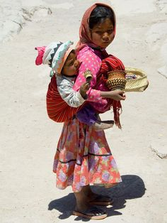Tarahumara girl Nola carrying her brother Reyo. Yup..My Grama was Tarahumara..so that makes me the same..right??