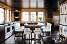 Love the darker stained ceilings that go throughout this camp house by Bobby McAlpine & Susan Ferrier