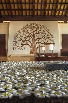 The Kalpataru, The Tree of Life, watches over the lobby at The Ritz-Carlton, Bali. It represents rejuvenation and the rediscovery of our harmony with nature and loved ones. This theme is carried throughout our resort with natural wood and bamboo elements.
