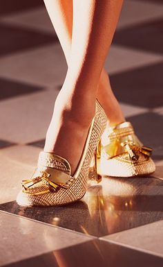 Tory Burch's Careen loafer pump reimagines the prep staple with gold metallic leather trim and a gold mirrored heel. Wear this tomboy-chic pair to give polish to any look.
