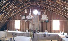 Long tables, short white cloths, barn.