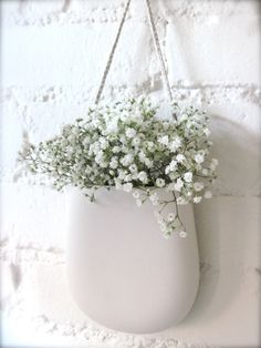Simple White Porcelain Hanging Wall Pocket. $49.00, via Etsy.