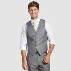 Want a more dapper look? Add a vest to your textured gray suit for an extra polished look. When all the jackets come off, you will be sure to stand out from the crowd! Grey Vest, Gray Jacket, Gray Groomsmen Suits, Light Grey Suits, Slim Fit Jackets, Suit Vest, Polished Look, Clothes, Wedding