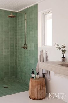 This modern wet room has used green patterned tiles to create the frame of the shower meaning that there is no glass needed in this wet room bathroom. Natural textures, materials and colours have been…More Wet Room Bathroom, Brass Bathroom, Modern Bathroom, Small Bathroom, Bathroom Ideas, Green Bathroom Tiles, Nature Bathroom, Green Bathrooms, Bathroom Colours