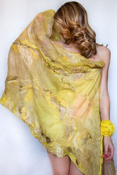GOLDEN LIGHT V.2 shawl is OOAKpiece.  Maded of natural material is perfect for ecolovers. Texture is created by hight quality materials. Colored by me from plants its perfect for ecolovers.  Confortable, light and very soft on you skin, a shiny and shear silk make the colors bright and delicate.  Diffent shades of yellow and golden beige make the color delicate and shiny. A small amount of wool makes this wrap confortable to wear in spring and summer.  Materials: silk pongee, mulberry silk…