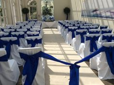 Buxted park hotel - orangery. sussex wedding venue. bespoke linen chair covers and royal blue taffeta sash decoration from pollen4hire