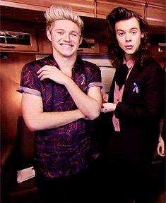 Harry tickling Niall