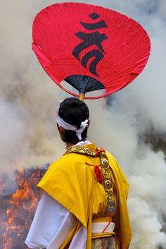 Yamabushi (warrior monk) fans the fire for The Setsubun Hoshi Matsuri at Kiburi Temple, Gifu, Japan
