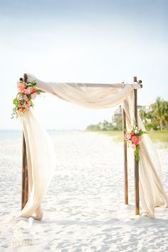 We are dying over these white sand beaches of Naples Florida.  This rare dark bamboo wedding arbor and mixed toned drapery were perfect | Laplaya Beach and Golf Resort | Set Free Photography | Isn't She Lovely Florals