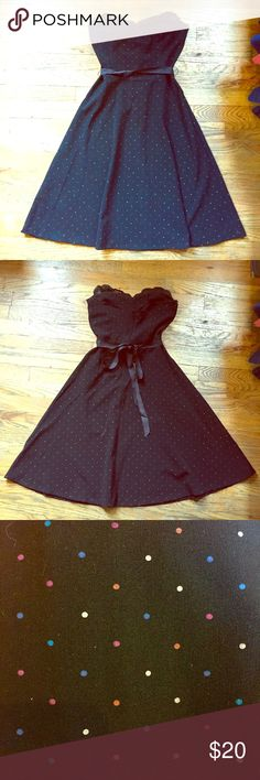 Black Polka-dot Cocktail Dress (Juniors) Classic cocktail dress! Black with small rainbow colored polka dots, lace detail on sweetheart top, and black ribbon belt. Tailored nicely to give a waist. 62% polyester, 33% rayon, 5% spandex. Ruby Rox Dresses