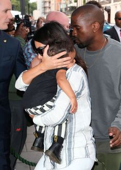 Kim Kardashian, Kanye West and North West arriving at their London hotel - 2 September.