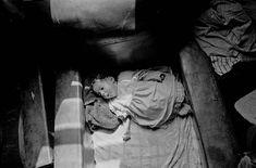 Baby asleep in armchair slum property Balsall Heath, Birmingham