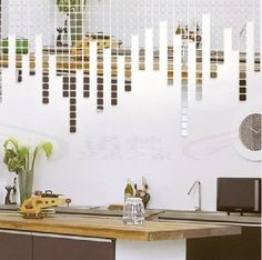 Interior design inspired by sound - small square mosaic mirror wall stickers to mimic sound bars.