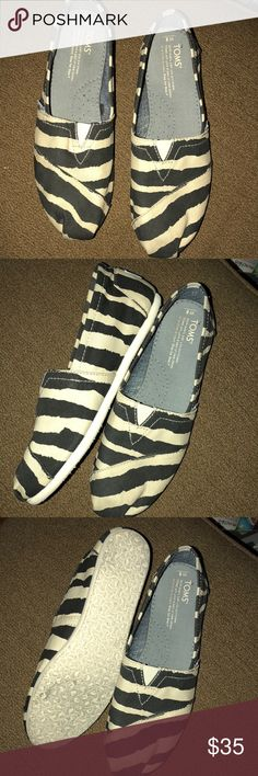 Super Cute zebra Toms. Excellent condition. Worn once!! Toms Shoes Flats & Loafers