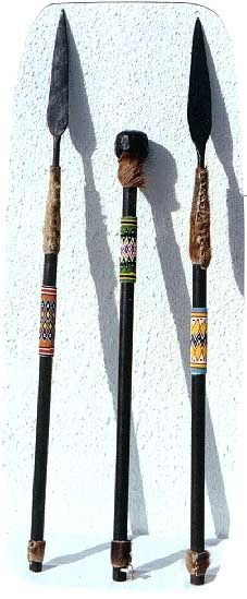 Zulu Beaded Stabbing Spears and War Clubs also known as the knobkerrie.
