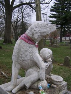 Woodland Cemetery (Ohio) is supposedly haunted. The most famous haunting is that of Johnny Morehouse and his dog. Legend has it that Johnny fell into the Miami & Erie Canal. His faithful dog tried to pull him out, but it was too late - the little boy froze to death. After he was buried, Johnny's dog laid on his grave and wouldn't move. In time, the dog died of starvation and a broken heart. In 1861, a special stone was made with a statue of Johnny and his dog.