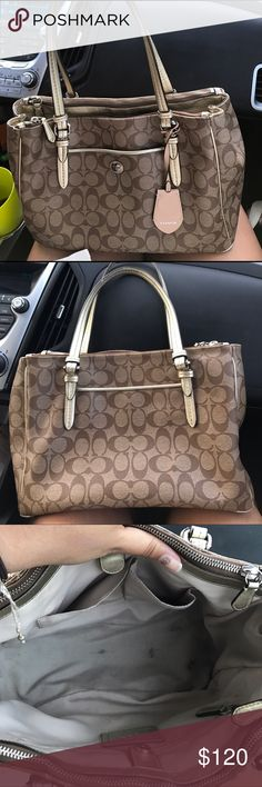 Coach purse This is a brown/tan Coach shoulder bag. It's a very roomy everyday bag that works for anyone. There are a few pen marks on the fabric inside the purse, but nothing someone with experience with stains can't lift. It's in great condition! Coach Bags Shoulder Bags