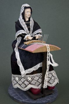 Belgium Lacemaker Doll Wearing Shawl, Dress, Scarf, and Apron Trimmed in Lace (Three Quarter View)