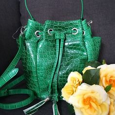 """Andie Bucket Bag in Green Croco Andre bucket bag from Snob Essentials. Top handle and optional shoulder strap. Two external side pockets on either side and interior zip pocket. Approximately 9-3/4"""" L, 6-1/2"""" W, 10"""" H. 6-1/2 L handle drop with removeable 24-1/2"""" L cross body strap. Never been worn. Silver hardware. Also available in Blue Saffiano  No trades.  No paypal. Instagram: @Jhennay262 Snob Essentials Bags Crossbody Bags"""