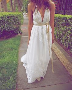 DIY a vintage wedding dress. Sleeves removed and changed to a halter neck with leather straps. By Shareen vintage